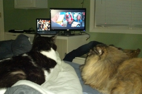 Watching Judge Dredd with his sister, Penny.